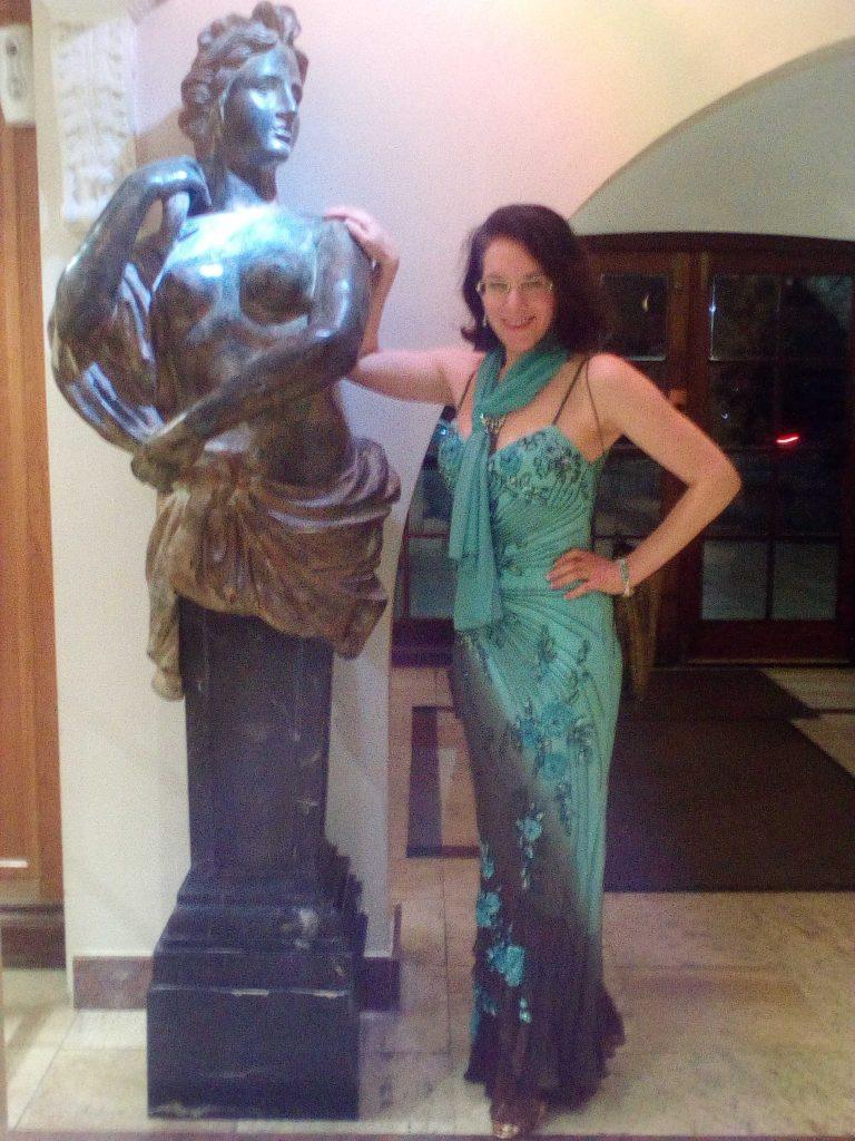 Event Companion Debra wearing light blue floor-length evening dress
