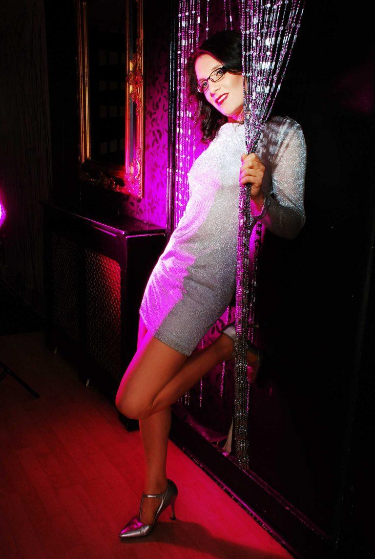 Event Companion photo Debra wearing silver Paco Rabbane mesh mini-dress