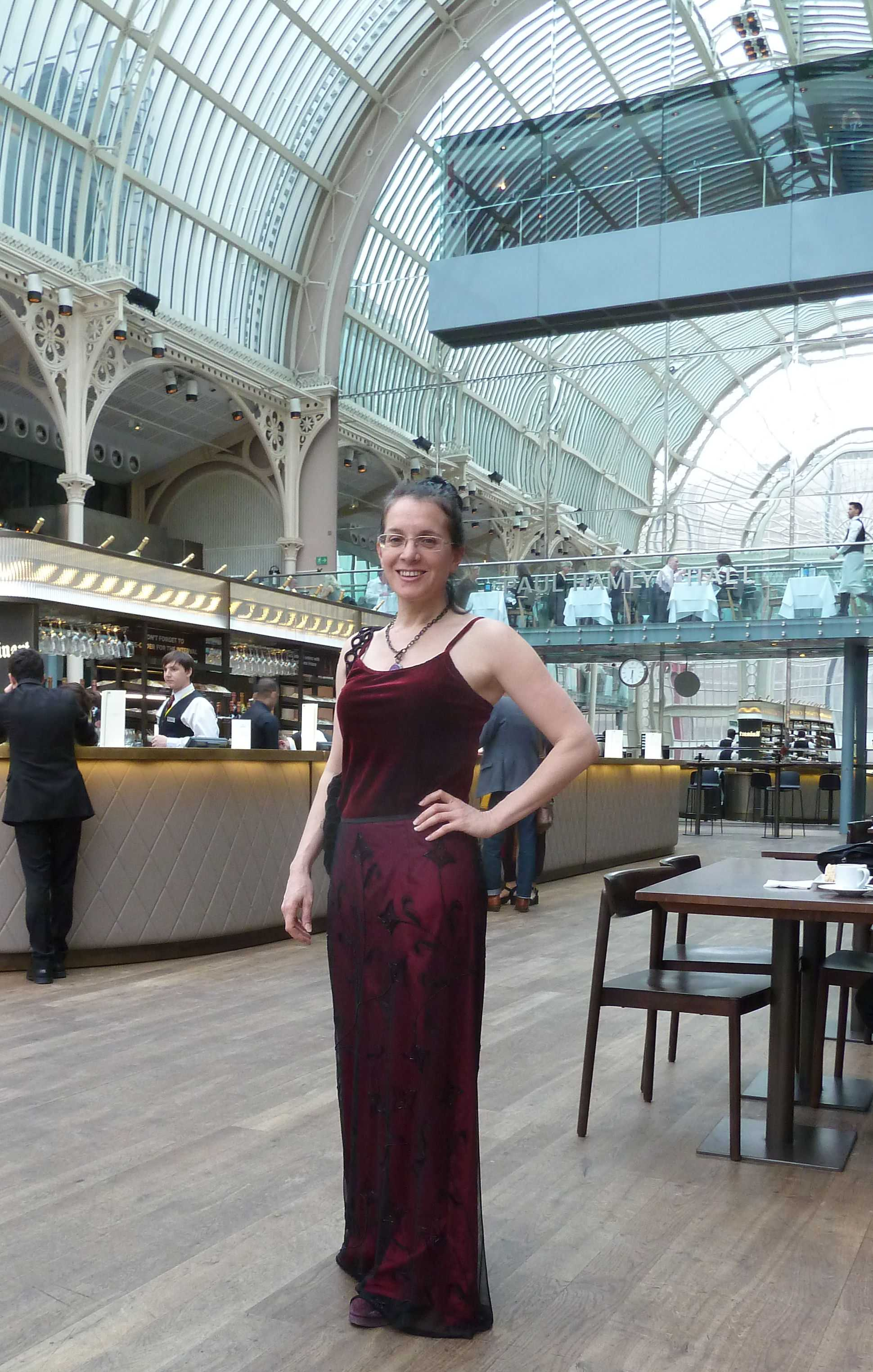 Event Companion photo Debra wearing burgundy floor-length evening dress at the Royal Opera House