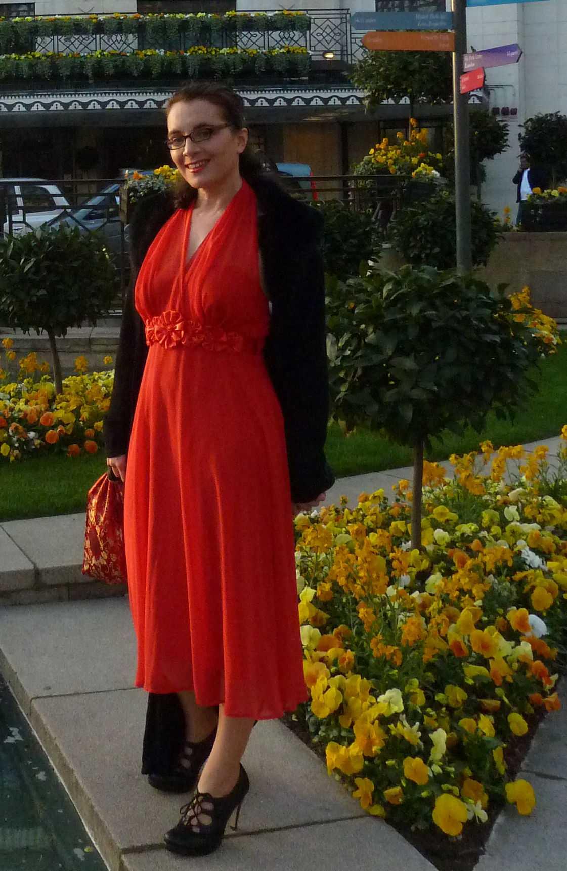 Event Companion photo Debra wearing red calf-length evening dress