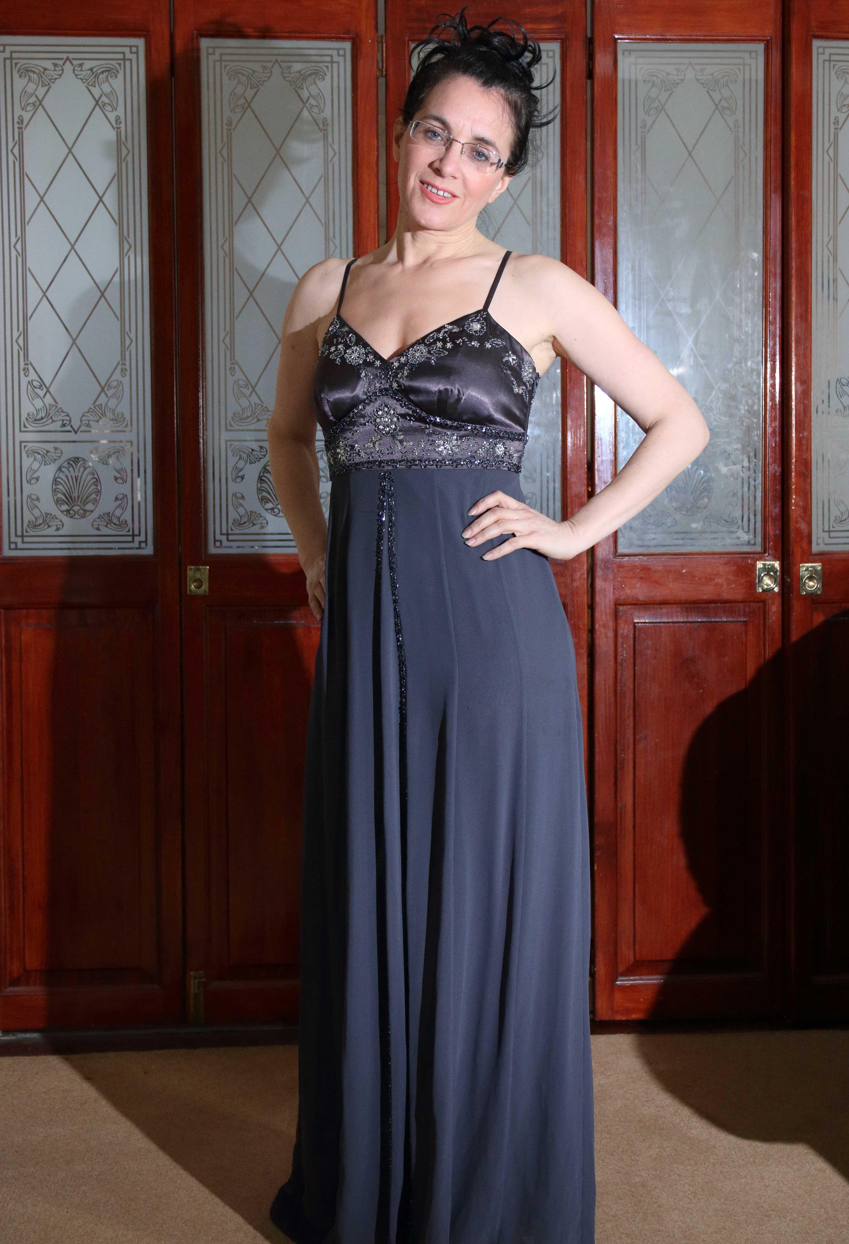 Event Companion photo Debra wearing silver-grey floor-length evening dress