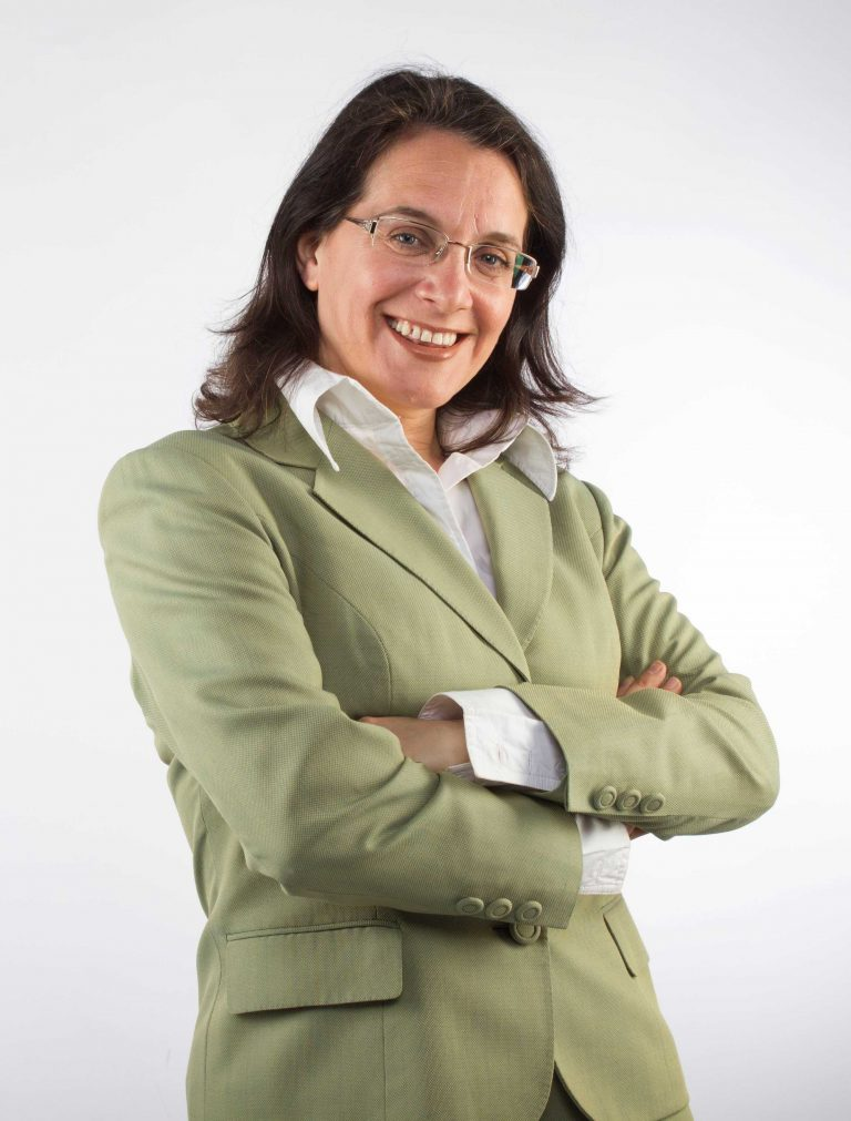 Event Companion photo Debra wearing light green suit