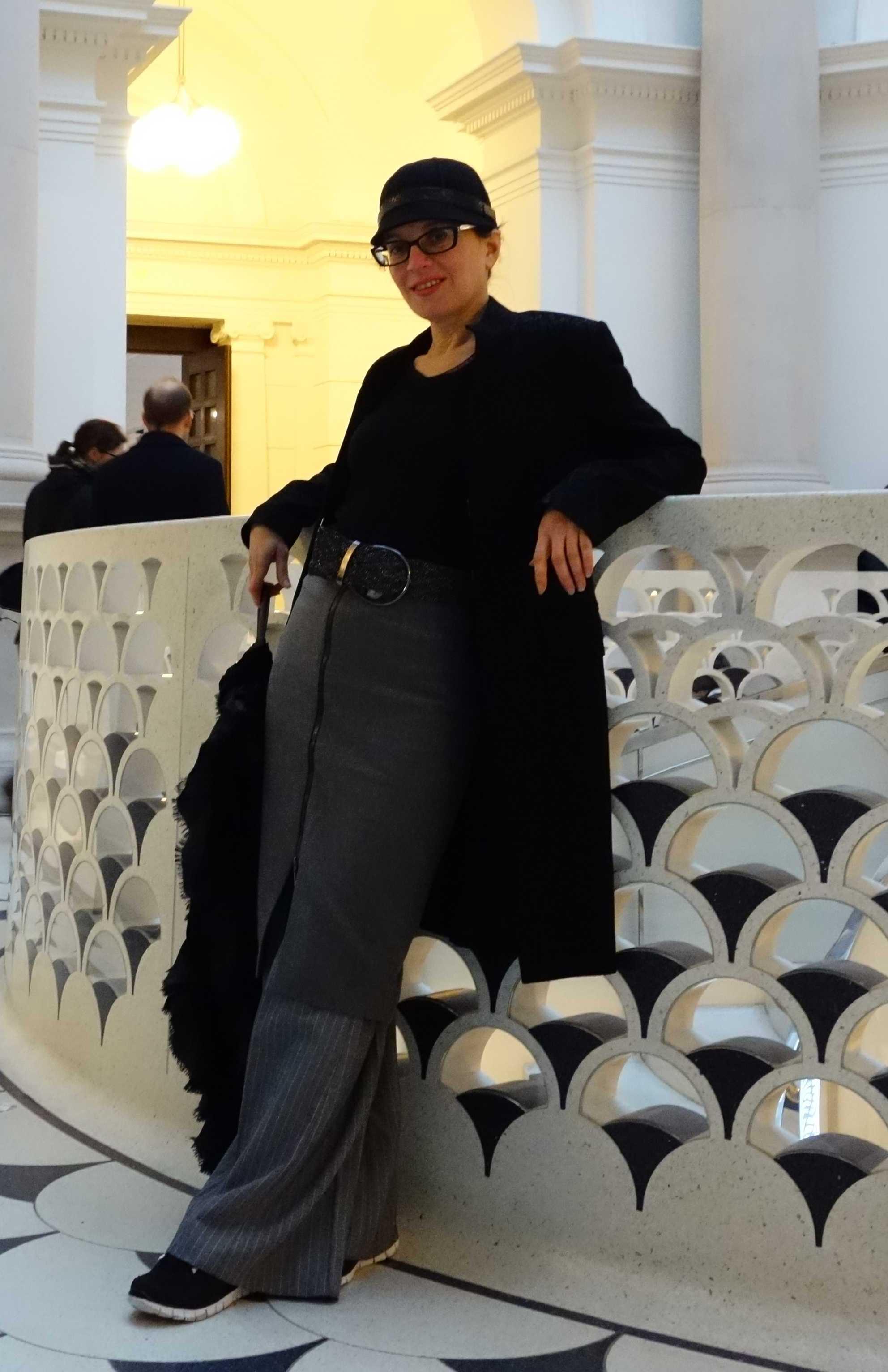 Event Companion photo Debra wearing pencil skirt over long-legged trousers